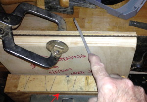 Below my hand you can see a scrap with angled lines. This is an aid to help stay consistent with the angle on cross-cut saws.