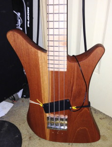 Bass body showing a bit more of the contraption I made to hold the pickup where I wanted, during test playing.