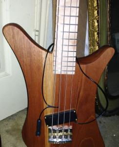 Bass showing Lace Sensor solidly attached with brass screws, and pickup's cable/jack.