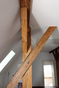 Post, beam, and diagonal members, all tied up into one, and inside the living quarters.