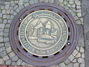 Cool man-hole cover in gold (colored).