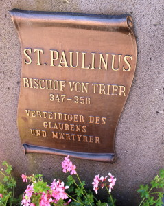 Plaque of information for St. Paulinus, below his statue.