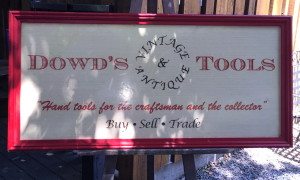Dowd's sign on its tripod.