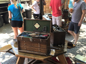 One of many tool chests, along with mingling patrons.