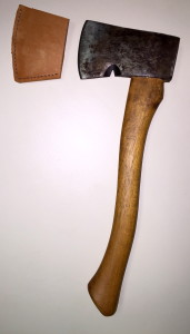 Plumb hatchet with it's head next to it's new head-cover.
