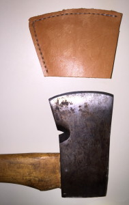 Closeup of the Plumb's head and the leather head-cover (or perhaps it should be called an edge-cover).