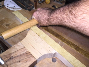 Leather applied to lip, using a large dowel to apply pressure.