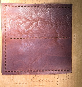 Top piece of leather for the holster, with the holes created from my 4-tooth Thonging tool.