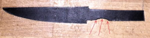 Knife blade blank before grinding/sharpening, with part of a circle (red arrows) as part of the tang.