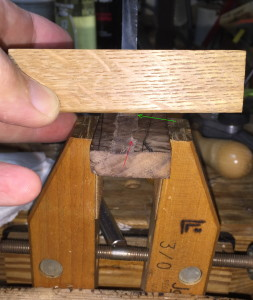 Up close of router plane, blade (green arrow), and narrowing of tang groove (red arrow) where the wood shape matches that of the tang (circle).