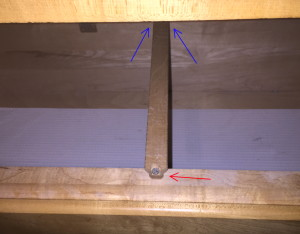 The runner for the top drawer in the dresser, with the screw intact at the red arrow, and the missing screw's location in the area of the blue arrows.