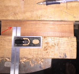 Cherry guide material clamped in the face vise, elevated slightly so my square could register against it to maintain the runner's orientation while drawing around it.