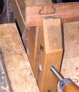 After creating the area to evacuate on the guide, I clamped the cherry in a small turn-screw, while clamping the turn-screw in the face vise. This elevated the piece to a nice height for sawing.