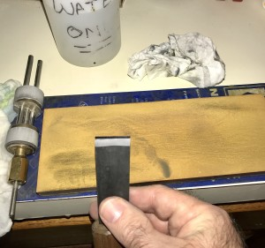 Here I've just finished sharpening the skiving knife on the Norton 8000-grit water stone, and the Kell honing guide is seen to the left of the stone.