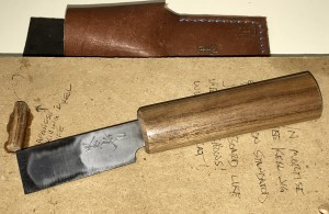 The back side of the blade on the Japanese skiving knife.
