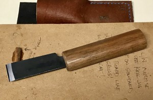 The bevel side of the blade on the Japanese skiving knife.